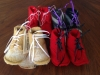 white, red and purple booties